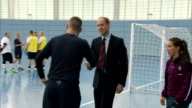 interior shots of Prince William Duke of Cambridge walk into sports hall with Homeless FA Patron Fara Williams and talk to Head of Homeless FA Gareth...