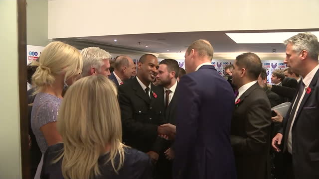 Interior shots of Prince William greeting celebrities and nominees at the Pride of Britain Awards including television presenters Philip Schofield...