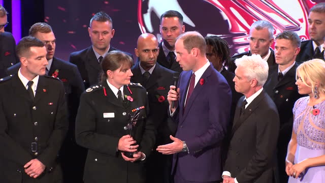 Interior shots of Prince William presenting the This Morning Emergency Services Award to the members of the London Fire Brigade who responded to the...