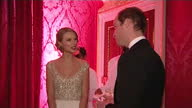 Interior shots of Prince William speaking to Taylor Swift at the Winter Whites gala at Kensington Palace Prince William attends Winter Whites gala at...