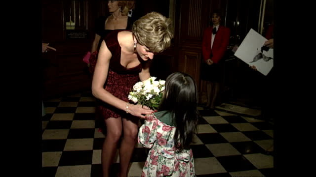 Interior shots of Princess Diana Princess of Wales arriving at Her Majesty's Theatre for Aids Day function wearing Burgundy velvet dress on 1...