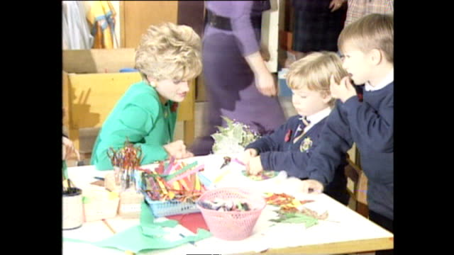 Interior shots of Princess Diana Princess of Wales being shown round British school and meeting small children in classroom during Royal tour on 6...