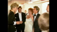 Interior shots of Princess Diana Princess of Wales walking into room and greet celebrities including Cliff Richard Lionel Blair Tom Jones Joan...