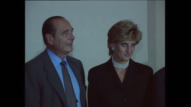 Interior shots of Princess Diana standing for a photocall with French President Jacques Chirac and his wife Bernadette and exterior shots of Princess...