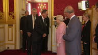 Interior shots of Queen Elizabeth II and Prince Charles greeting guests at a reception to bring together the community of Commonwealth Organisations...