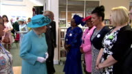 Interior shots of Queen Elizabeth II and Prince Philip being introduced to local community leaders at Chadwell Heath Community Centre on July 16 2015...