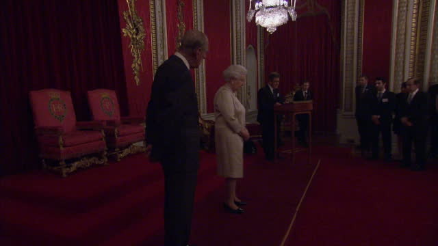 Interior shots of Queen Elizabeth II and Prince Philip presenting awards for The Queen Elizabeth Prize for Engineering Foundation event at Buckingham...