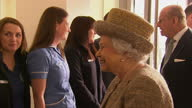 Interior shots of Queen Elizabeth II meeting staff and volunteers at Battersea Dogs Home and being introduced to Battersea Abassadors including Paul...