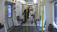 Interior shots of Queen Elizabeth II on tube carriage speaking to London Underground workers and looking around train carriage Royal visit to Baker...