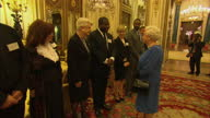 Interior shots of Queen Elizabeth II speaking to Dame Angela Lansbury and director Steve McQueen at a reception to celebrate the dramatic arts in the...