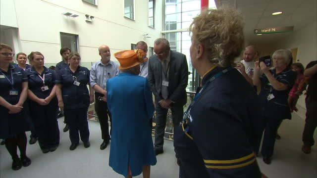 Interior shots of Queen Elizabeth II visiting the Royal Manchester Children's Hospital and greeting staff after the Manchester terror attack on 25th...