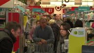 Interior shots of queues and people shopping in Morrisons supermarket waiting to pay at the tills Panic buying at Supermarkets for Christmas on...
