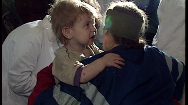 Interior shots of refugees in a sports hall in Srebrenica including young children with mothers some of them injured on April 13 1993 in Srebrenica...