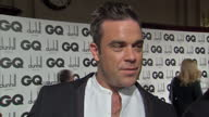 Interior shots of Robbie Williams giving an interview on the red carpet at the GQ Awards Red Carpet Interviews from the GQ Awards at Royal Opera...