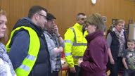 Interior shots of Scottish First Minister Nicola Sturgeon walking into a community centre in Newton Stewart and meeting local people and volunteer...