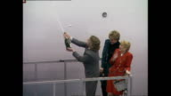 Interior shots of Sir Richard Branson spraying champagne over new Virgin Airbus and Princess Diana Princess of Wales before boarding plane for tour...