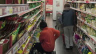 Interior shots of staff stacking shelves serving customers at a Polish supermarket on March 29 2017 in Thetford Norfolk England