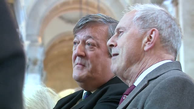 Interior shots of Stephen Fry and Giles Brandreth speaking together in the congregation at St Paul's Cathedral before a memorial service for...