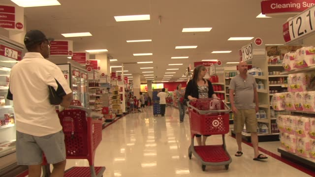 Interior shots of Target / Shoppers making purchases in various department / Shoppers pushing shopping carts through aisles inside store / Moving...