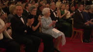 Interior shots of the audience including Queen Elizabeth II applauding after a performance by members of the London Symphony Orchestra at a reception...