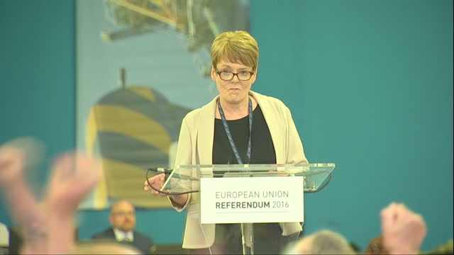 Interior shots of the counting officer declaring EU referendum results with the majority of votes cast to leave the EU and audience cheering on June...