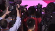 Interior shots of the crowd at an announcement at the Alibaba offices in Hangzhou China on Wide shots of a crowd of people in stadium seating using...