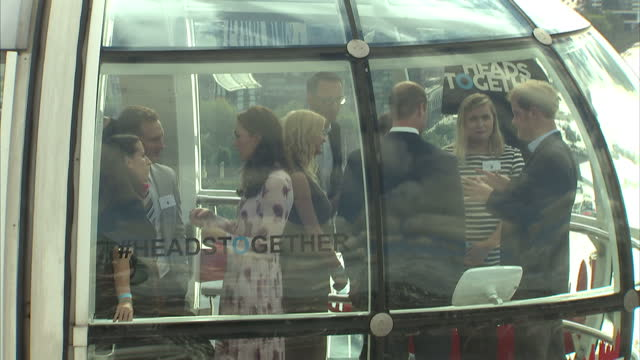 Interior shots of the Duke and Duchess of Cambridge and Prince Harry speaking with guests on board a pod on the London Eye during a Heads Together...