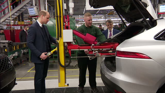 Interior shots of the Duke and Duchess of Cambridge touring the production line and speaking to staff during a visit to Jaguar Land Rover's Solihull...