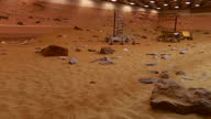 Interior shots of the Mars yard test area at Airbus Defence and Space in Stevenage showing the simulated Martian landscape and various Mars rover...