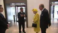 Interior shots of The Queen and Duke of Edinburgh inspecting a bomb disposal robot whilst visiting the new headquarters of Scotland Yard on 13 July...