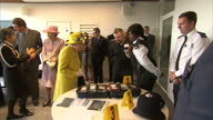 Interior shots of The Queen and Duke of Edinburgh meeting police personnel whilst visiting the new headquarters of Scotland Yard on 13 July 2017 in...