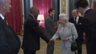 Interior shots of the Queen and Duke of Edinburgh speaking to Royal Life Saving Society medal winners Tyler Bailer and Zac Dominic and Professor John...