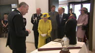 Interior shots of The Queen and Prince Philip inspecting various historical items on display whilst visiting the new headquarters of Scotland Yard on...
