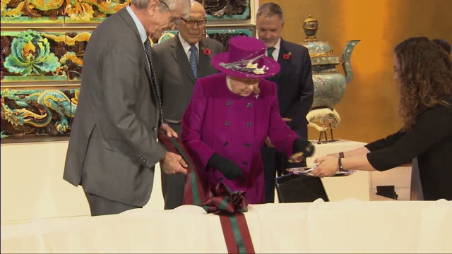 Interior shots of the Queen listening to a speech by Sir Richard Lambert Chairman of the Trustees of the British Museum before cutting a ribbon to...