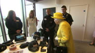 Interior shots of The Queen with inspecting various police equipment and meeting a police dog whilst visiting the new headquarters of Scotland Yard...