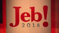 Interior shots of the stage set for Jeb Bush's speech to the American Conservative Union with a screen proclaiming 'Jeb2016com' and workers unfurling...
