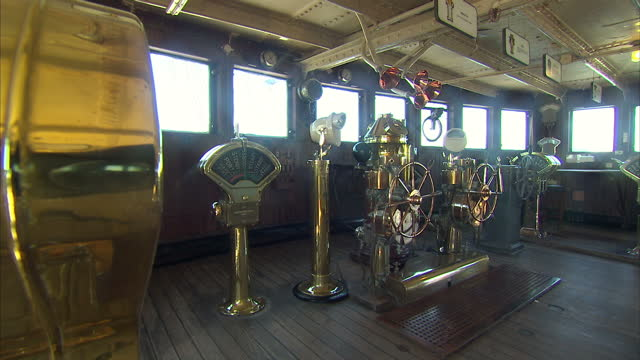 Interior shots of the wheel house or bridge of the docked Queen Mary historic cruise liner including polished brass wheels etc on November 09 2014 in...