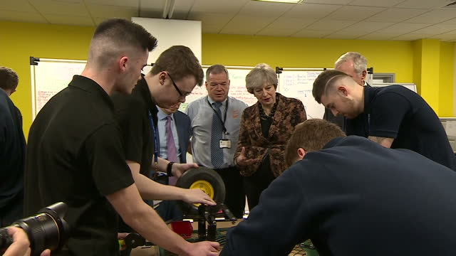 Interior shots of Theresa May meeting apprentices and touring the EEF Technology Hub with Chancellor Philip Hammond on November 20 2017 in Birmingham...