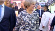 Interior shots of Theresa May speaking to butchers during a visit to Smithfield market accompanied by her husband Philip on the last day of...