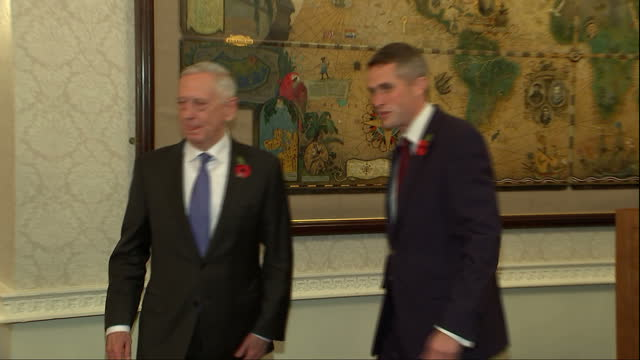 Interior shots of UK Defence Secretary Gavin Williamson and US Secretary of Defence James Mattis looking at a map on the wall of a conference room at...