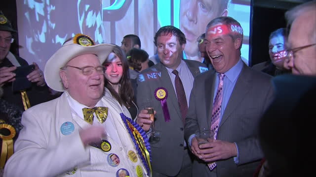 Interior shots of UKIP leader Nigel Farage and Mark Reckless celebrating after winning the Rochester and Strood byelection>> on November 21 2014 in...