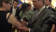 Interior shots of UKIP leader Nigel Farage meeting a woman with a tattoo of him on her arm and signing it on September 25 2015 in Doncaster England