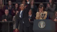 Interior shots of US President Barack Obama First Lady of the US Michelle Obama waving at podium after speeches shaking hands greeting students in...