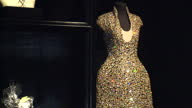Interior shots of various couture items designed by Alexander McQueen on display in the 'Savage Beauty' exhibition at the Victoria and Albert...