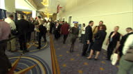 Interior shots of various delegates and stands at a CPAC conference including NRA News supporters of Rick Santorum Liberty University School of Law...