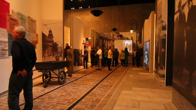 Interior shots of visitors to the Vad Vashem museum in Jerusalem looking at holocaust exhibits including the twisted remains of Auschwitz's 'Arbeit...