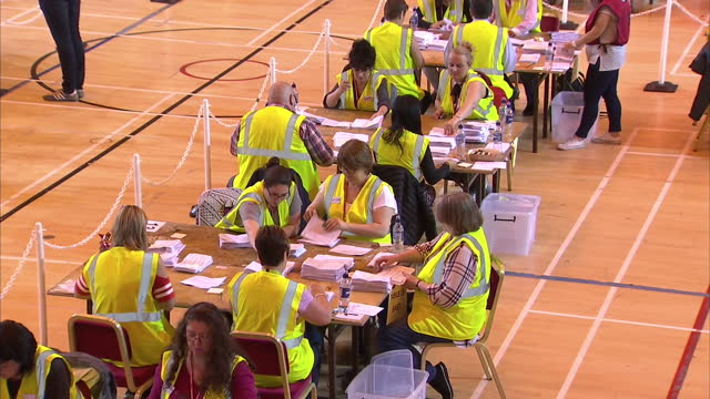 Interior shots of volunteers counting ballots for the UK EU referendum on June 24 2016 in Edinburgh Scotland