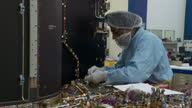 Interior shots of workers assembling and checking satellite components in a workshop at Airbus Defence and Space in Stevenage on February 28 2017 in...