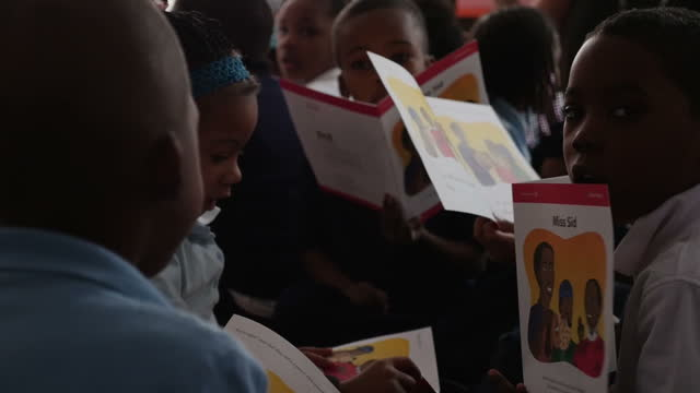 Interior shots of young black school children reading story books sat in a classroom on January 22 2016 in Flint Michigan