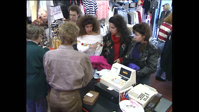 Interior shots of young ladies shopping in a fashion shop 'Le Pop' on January 29 1989 in London England